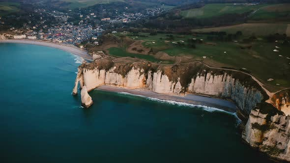 Thumbnail for Drone Approaching Epic White Chalk Cliff Bay Coastline and Amazing Azure Sea Near Beautiful Town
