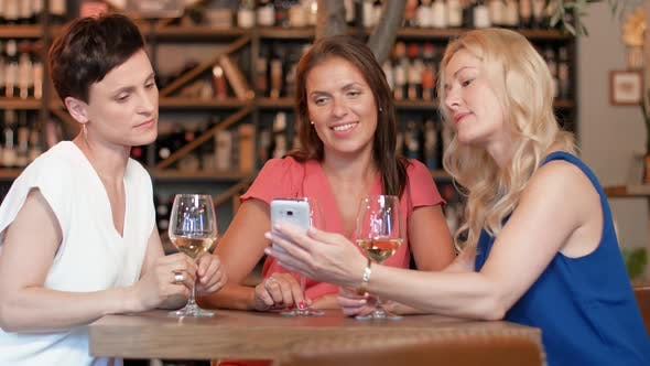 Thumbnail for Women with Smartphone at Wine Bar or Restaurant