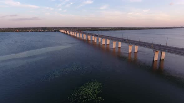 Thumbnail for Aerial Shot of a Far-off Bridge Over the Dnipro From a Drone Flying Along in Summer
