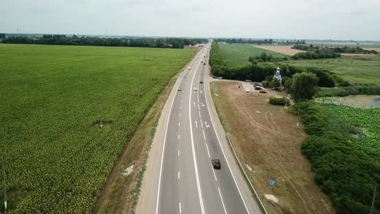 Thumbnail for Aerial Fly Over Motorway, Freeway Traffic - Trucks and Cars on the Road.