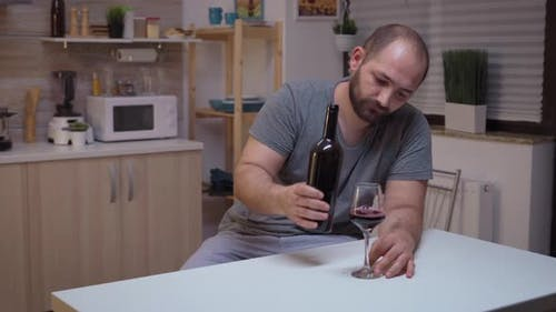 Depressed Man Drinking Alone