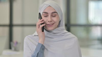 Young Arab Woman Talking on Smartphone