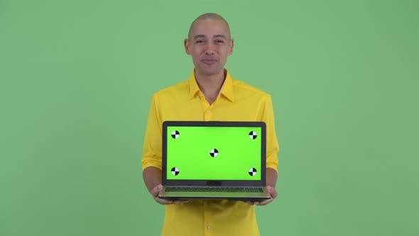 Thumbnail for Happy Handsome Bald Businessman Talking While Showing Laptop