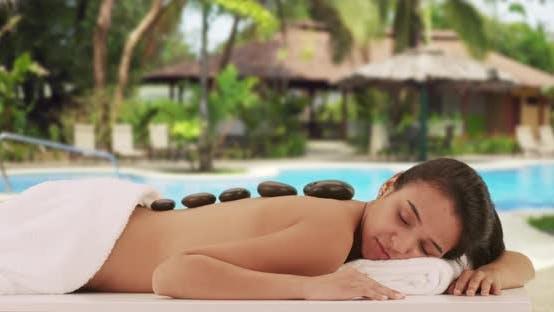 Thumbnail for Mexican woman enjoying massage at a resort