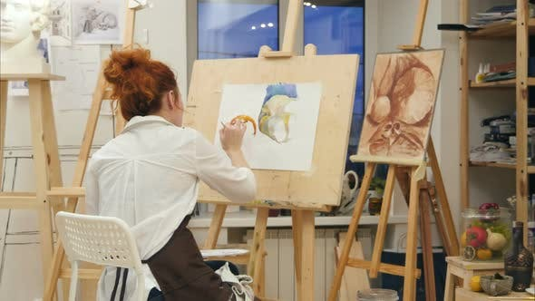 Thumbnail for Woman Artist Painting Watercolor Picture in Her Studio