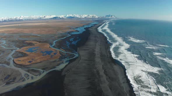 Aerial View of Patterns of Icelandic Rivers Flowing Into the Ocean. Iceland in Early Spring