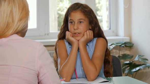 Thumbnail for Adorable Happy Young Girl Talking To Her Teacher at Class