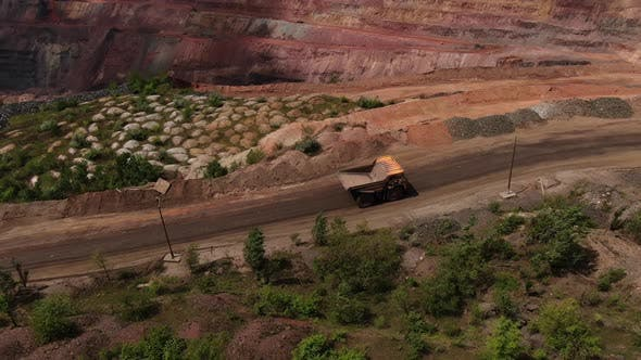 Huge Truck Is Driving on a Road Near a Huge Quarry