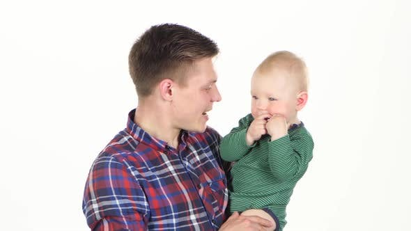 Thumbnail for Father Playing with His Baby, White