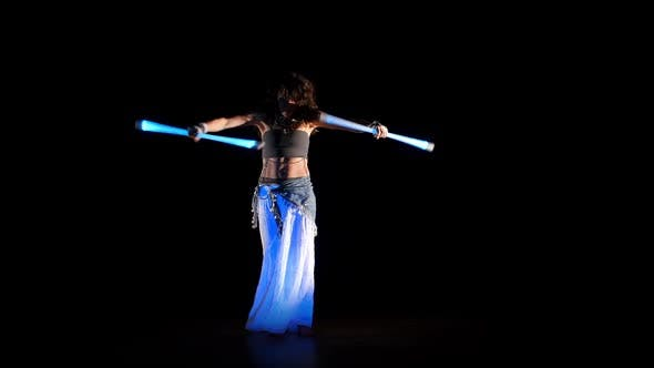 Cover Image for Beautiful Gipsy Woman Dancing In Neon Light With Ultraviolet Staffs 5
