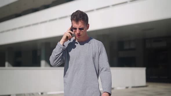 Thumbnail for Handsome Angry Man Talking on Phone and Yelling Other Person with Anger