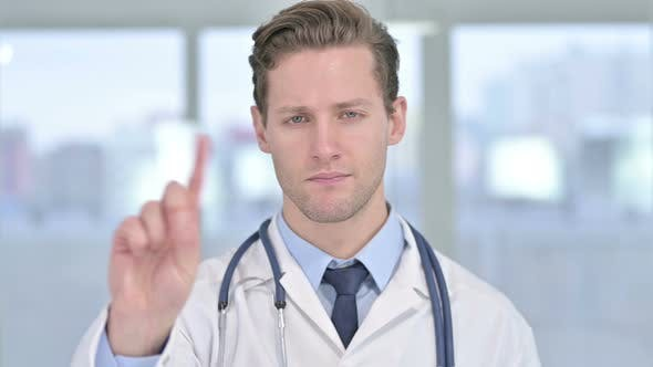 Cover Image for Portrait of Young Male Doctor Saying No with Finger Sign
