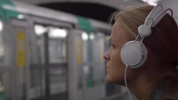 Thumbnail for Woman Listening To Music in Subway