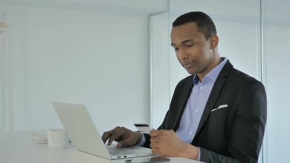 Cover Image for Online Shopping By Casual Afro-American Businessman, Online Payment at Work