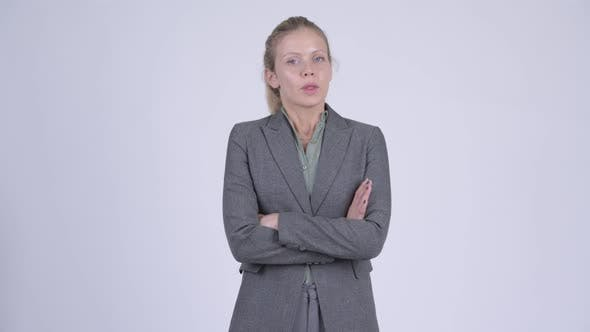 Cover Image for Young Angry Blonde Businesswoman with Arms Crossed