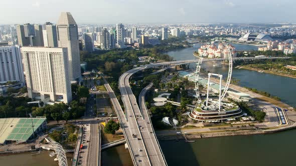 Thumbnail for Road Highway with Ferris Wheel To the Day Time Cityscape Skyline at Singapore
