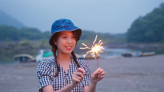 Thumbnail for Woman Play Sparkler Firework