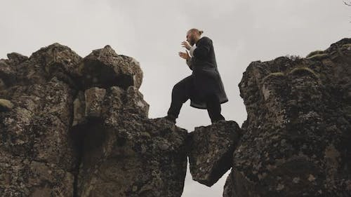 Kung Fu Master Performing Karate Moves On Rocks In Iceland
