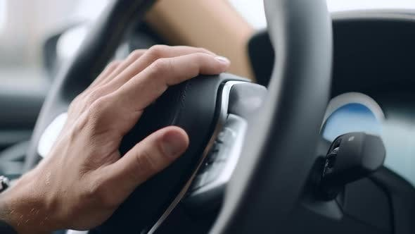 Nervous Unrecognized Driver Beeping in Car. Closeup Male Hand Pushing Horn