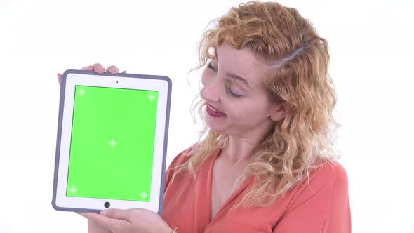Thumbnail for Face of Happy Beautiful Blonde Businesswoman Showing Digital Tablet