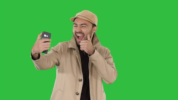 Thumbnail for Young adult man handsome taking selfie on a Green Screen
