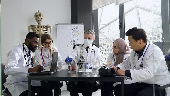Thumbnail for Doctor During His Lecture with Multiracial Good-Looking Doctors-Interns