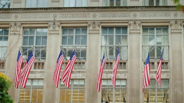 Thumbnail for A Row of American Flags on the Facade of the Administrative Building in New York