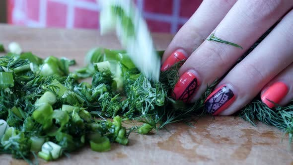 Cover Image for Female Prepares Vegetable Salad Chopped Dill and Green Onions
