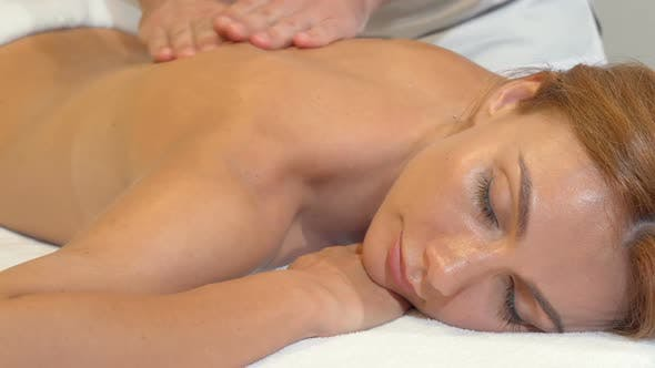 Thumbnail for Cropped Shot of a Gorgeous Woman Enjoying Massage at Spa Center