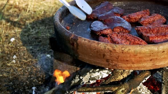 Thumbnail for Making Sausage Inan Old Pot On Wooden Fire 1