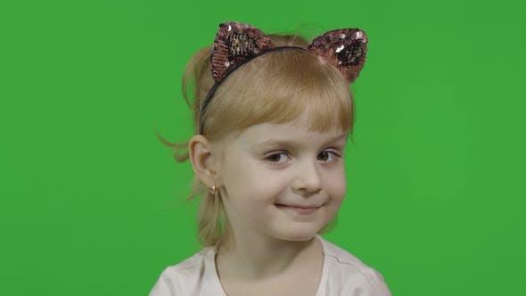 Thumbnail for Girl in Cat Headband Winks
