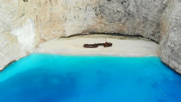 A Drone Flies Back Over Shipwreck Beach of Zakynthos Island on a Sunny Day