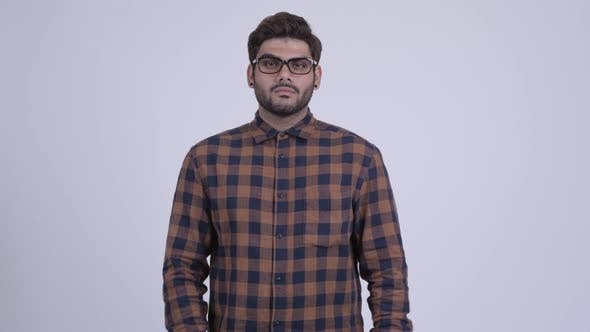 Thumbnail for Young Bearded Indian Hipster Man with Arms Crossed