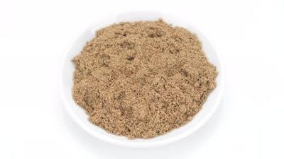 coriander powder top view on white background, rotation