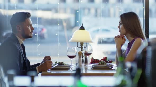 Thumbnail for Couple Talking on Date in Restaurant