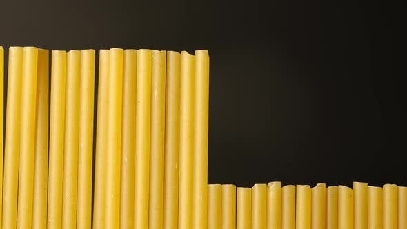 Cover Image for MACRO: Spaghetti Lift Up In Sequence On Black Background - Stop Motion