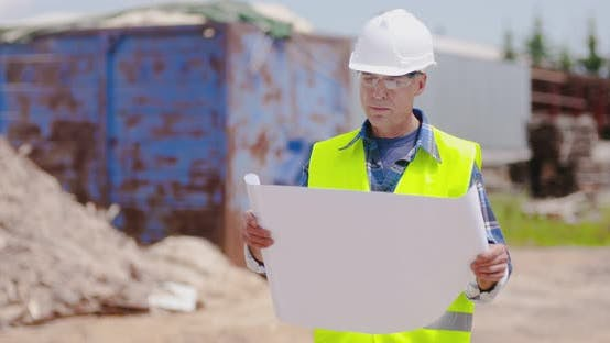 Thumbnail for Confident Mature Male Engineer Analyzing Blueprint