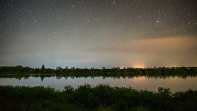 Starry Night Sky Stars over Calm Lake in New Zealand