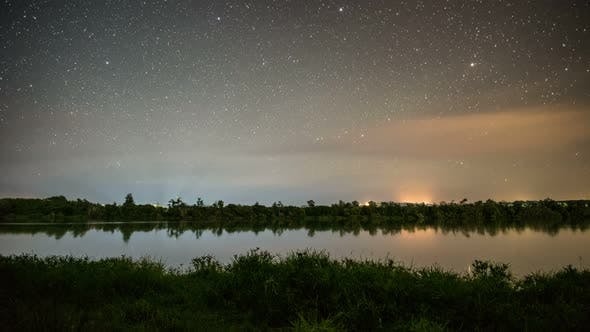 Thumbnail for Starry Night Sky Stars over Calm Lake in New Zealand