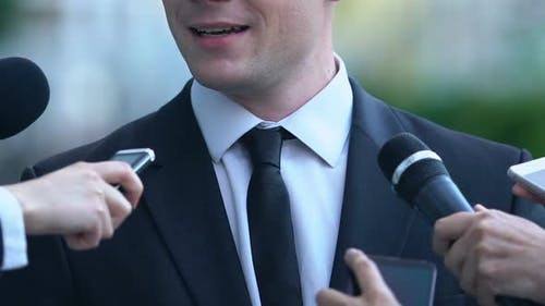 Politician Commenting on Elections Campaign, Journalists With Tape Recorders