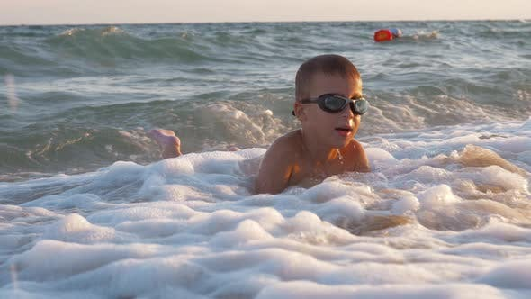 Thumbnail for Child Is Excited with Sea Waves Covering Him