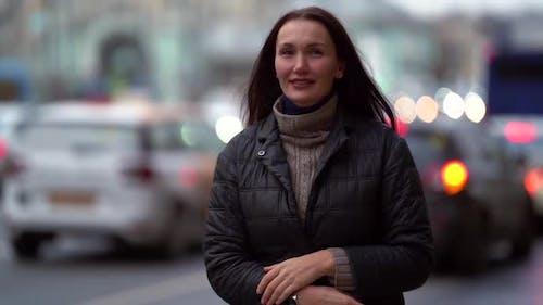 Adult Townswoman Is Walking Alone in City, Strolling Over Wide Avenue Near Road