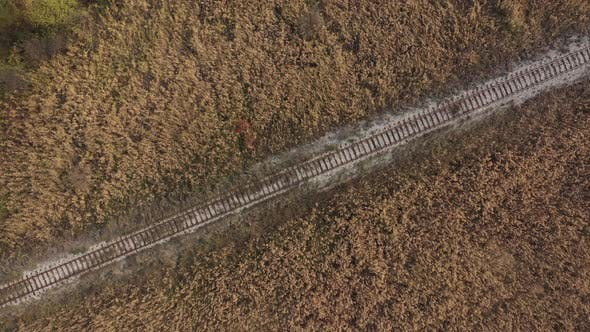 Top view of old railway track in the field 4K drone footage