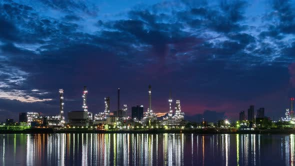 Oil refinery petrochemical and energy industry during morning sun rise, night to day - Time-lapse