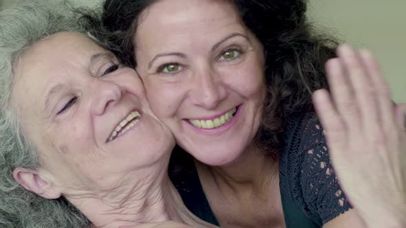Thumbnail for Two Smiling Mature Women Looking at Camera.