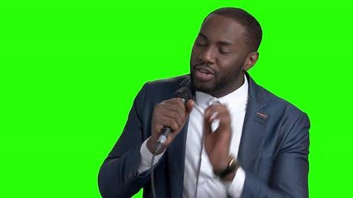 Afro-american Tv Presenter on Green Screen.