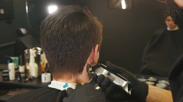 Thumbnail for Barber Makes Hair Edging on the Client with a Hair Trimmer