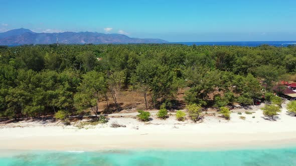 Thumbnail for Wide angle aerial tourism shot of a summer white paradise sand beach and blue water background