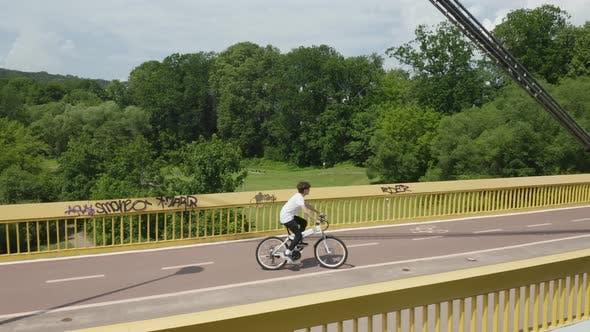 Thumbnail for Riding Bicycle on a Pedestrian Bridge