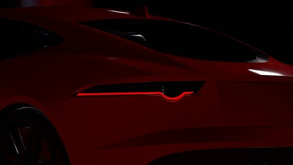 Thumbnail for Rear Shot of Luxury Red Sports Car Headlights